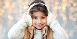 happy little girl wearing earmuffs