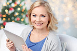 happy woman with tablet pc at christmas