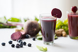 glass of beetroot juice with fruits and vegetables