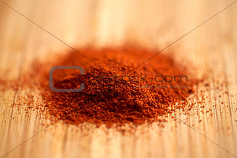 cayenne pepper or paprika powder on wood