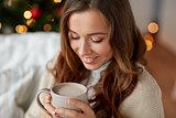 close up of woman drinking cocoa at christmas