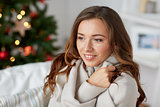 happy young woman with plaid at home for christmas