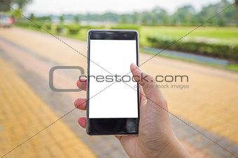 Right hand holds mobile phone with black white background