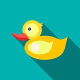 Children's toy duck on blue-green background