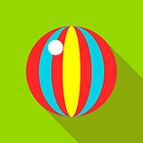 Children's toy ball with stripes on a bright green background