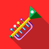 Children's toy musical trumpet on red background