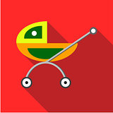 Children's toy pram on a red background