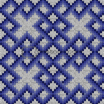Knitting ornate seamless pattern in blue and white colors