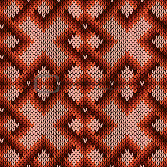 Knitting ornate seamless pattern in warm hues