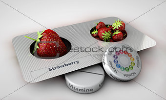 Close up of Strawberry and pills isolated - vitamin concept