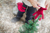 Mother Putting Red Mittens On Child with Snow Effect