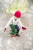 Girl In Red Mittens and Cap Near Small Christmas Tree with Snow