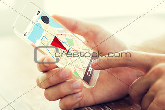 close up of hand with navigator map on smartphone