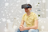 young man in virtual reality headset or 3d glasses
