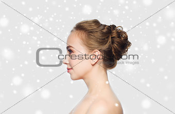 beautiful young woman face over snow