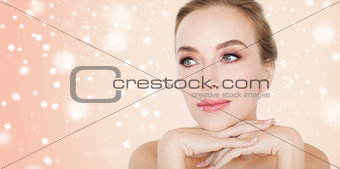 close up of beautiful young woman face and hands