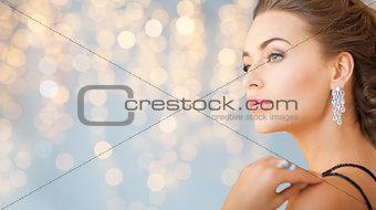 close up of woman with diamond earring