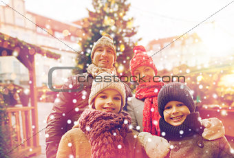 happy family over city christmas tree and snow