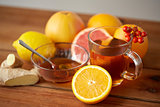tea with honey, lemon and ginger on wood