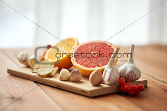 citrus, ginger, garlic and rowanberry on wood