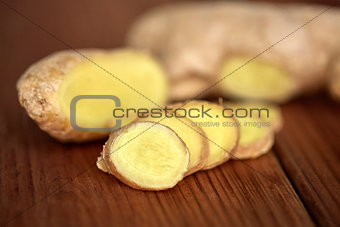 close up of ginger root on wooden table