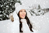 happy woman outdoors in winter clothes