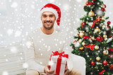 happy man with christmas gift box at home