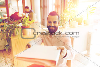 happy creative male office worker with folfer