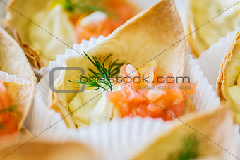 close up of dough cornet with salmon fish filling