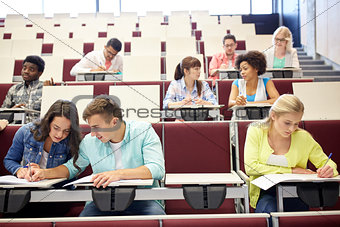 group of students with notebooks at lecture hall