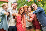 happy friends with drinks at summer garden party