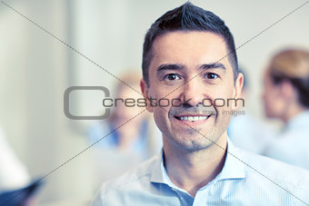 smiling businessman face in office