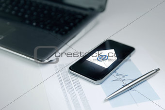 close up of smartphone with email message icon