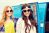 smiling young hippie women over minivan car