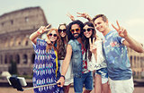hippie friends with smartphone selfie stick