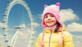 happy little girl over london ferry wheel