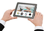 close up of hands holding tablet pc with