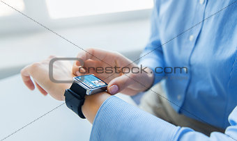 close up of hands with business news on smartwatch