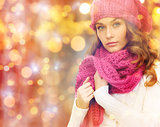 woman in hat and scarf over christmas  lights