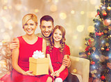 smiling family holding gift box