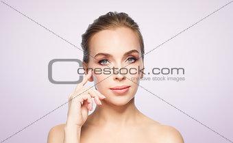 beautiful young woman showing her cheekbone