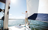 senior man on sail boat or yacht sailing in sea