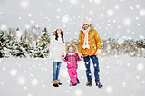 happy family with child in winter clothes outdoors