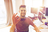 happy creative male office worker showing ok sign