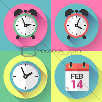 Alarm clock, office clock and calendar with a date of Valentines Day.