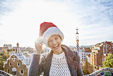 happy traveller woman in Santa hat at Guell Park in Barcelona