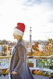 tourist woman in Santa hat at Guell Park looking into distance