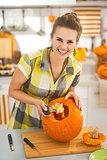 housewife prepare big orange pumpkin for Halloween party