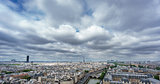 Eiffel and Montparnasse towers over Paris, cloudy day
