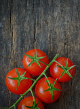 Cherry tomatoes on wooden